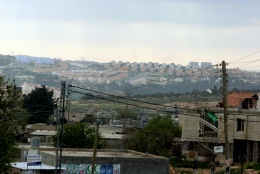 Bilin village with Modi'in settlement in the background (West Ramallah). Photo: Bassam Almohor