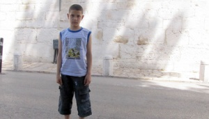 Palestinian Child Knocked Down and Physically Assaulted by an Israeli