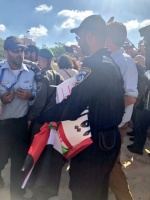 Israeli police after confiscating Palestinian flags and posters, Al-Haq © 14 May 2018, Jerusalem